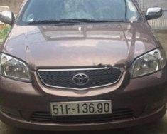 Bán Toyota Vios 2003, màu nâu, xe đang hoạt động bình thường giá 210 triệu tại Tp.HCM