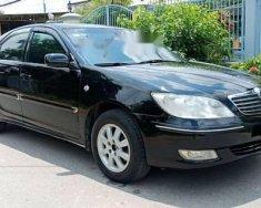 Bán xe Toyota Camry sản xuất 2004, màu đen giá 348 triệu tại Tp.HCM