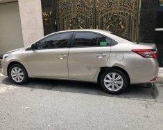 Bán xe Toyota Vios 1.5E 2017, màu vàng cát giá 530 triệu tại Tp.HCM