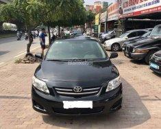 Bán ô tô Toyota Corolla 1.8 Gli sản xuất 2009, đăng ký 2010 màu đen, nhập khẩu, giá 520 triệu tại Hà Nội
