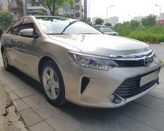 Bán Toyota Camry 2.5Q sản xuất 2015, màu vàng chính chủ giá 1 tỷ 45 tr tại Hà Nội