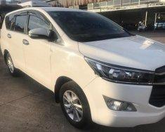 Cần bán Toyota Innova E đăng ký 6/2017 số sàn, màu trắng giá 718 triệu tại Tp.HCM