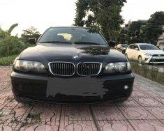 Cần bán BMW 3 Series 318i 2.0 AT sản xuất năm 2006, màu đen giá 255 triệu tại Hà Nội