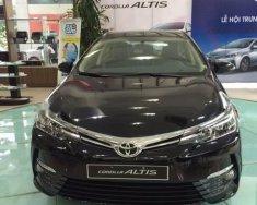 Bán xe Toyota Corolla 1.8E MT sản xuất năm 2018, màu đen, giá tốt giá 678 triệu tại Hà Nội
