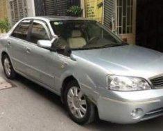 Bán Ford Laser Ghia 1.8 AT sản xuất năm 2004, màu bạc  giá 245 triệu tại Bình Phước