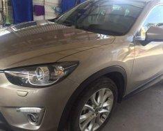 Chính chủ bán xe Mazda CX 5 đời 2013, màu vàng cát giá 669 triệu tại Hà Nội