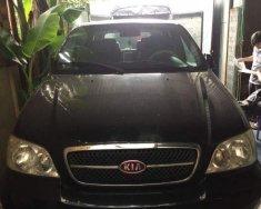 Bán Kia Carnival MT sản xuất năm 2006, màu đen, xe đẹp giá 210 triệu tại Tp.HCM