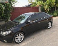 Cần bán xe Kia Forte sản xuất 2010, màu đen xe gia đình giá cạnh tranh giá 385 triệu tại Hà Nội