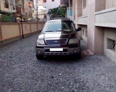 Bán xe Ford Escape 2004, màu đen, giá tốt giá 220 triệu tại Tp.HCM