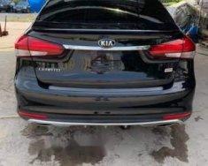 Bán ô tô Kia Rio năm 2014, màu đen giá 1 tỷ 200 tr tại Tp.HCM