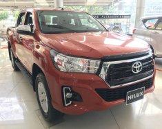 Bán Toyota Hilux 2.4 AT màu cam nhập Thái, giao xe tháng 11 giá 695 triệu tại Tp.HCM