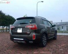 Chính chủ bán lại xe Kia Sorento DATH sản xuất 2015, màu nâu giá 825 triệu tại Hà Nội