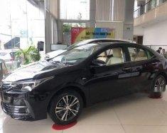 Cần bán xe Toyota Corolla Altis 1.8E CVT sản xuất 2018, màu đen, giá tốt giá 708 triệu tại Tp.HCM