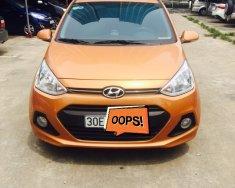 Cần bán xe Hyundai Grand i10 1.2 AT sản xuất năm 2016, màu cam, nhập khẩu nguyên chiếc, giá tốt giá 410 triệu tại Hà Nội