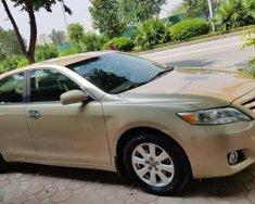 Cần bán xe Camry LE 2.5 2009 màu vàng, nhập khẩu giá 725 triệu tại Hà Nội