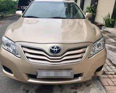 Bán xe Toyota Camry Le đời 2010, màu vàng cát giá 900 triệu tại Đồng Nai
