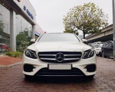 Bán Mercedes E300 AMG màu trắng, sản xuất 2016 tại Đức, đăng ký 12/2016 tên công ty giá 2 tỷ 390 tr tại Hà Nội
