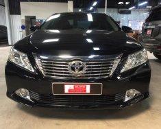 Bán Toyota Camry 2.0E đời 2013, màu đen giá 810 triệu tại Tp.HCM