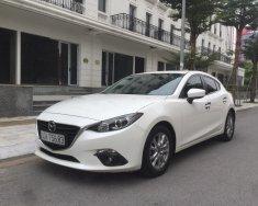 Bán xe Mazda 3 1.5L AT hatchback sản xuất 2015, màu trắng giá 605 triệu tại Hà Nội
