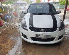Cần bán gấp Suzuki Swift đời 2014, hai màu, đi lại rất ít còn tốt giá 435 triệu tại Hà Nội