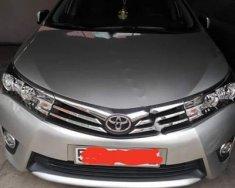 Chính chủ bán ô tô Toyota Corolla Altis 1.8G AT đời 2014, màu bạc, giá 640tr giá 640 triệu tại Tp.HCM