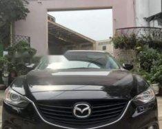 Cần bán Mazda 6 năm sản xuất 2014, màu đen, nhập khẩu nguyên chiếc giá cạnh tranh giá 679 triệu tại Tp.HCM