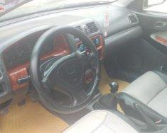 Cần bán xe cũ Mazda 323 đời 2000, màu đen, nhập khẩu nguyên chiếc giá 79 triệu tại Hải Dương