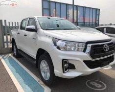 Bán ô tô Toyota Hilux 2.4E 4x2 AT đời 2018, màu trắng, nhập khẩu giá 695 triệu tại Hà Nội