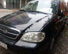 Chính chủ bán xe Kia Carnival GS 2.5 MT 2007, màu xanh đen giá 215 triệu tại Tp.HCM