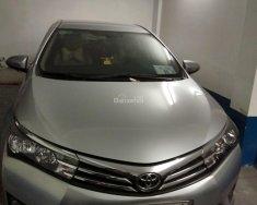 Cần bán xe Toyota Corolla Altis năm 2014, màu bạc giá 650 triệu tại Tp.HCM