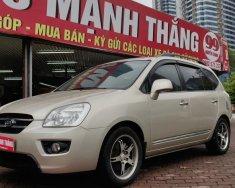 Cần bán Kia Carens 2.0 MT 2009, màu vàng giá 310 triệu tại Hà Nội