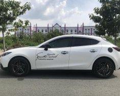 Cần bán gấp Mazda 3 năm 2015 màu trắng, giá 600 triệu giá 600 triệu tại Tp.HCM