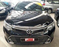Bán xe Toyota Camry 2.0E đời 2016, màu đen, rodai 33.000 km, giá thương lượng giá 920 triệu tại Tp.HCM