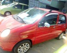 Bán Daewoo Matiz đời 2006, màu đỏ số sàn  giá 77 triệu tại Vĩnh Long