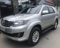 Cần bán xe Toyota Fortuner 4x2 AT đời 2014, màu bạc chính chủ giá 742 triệu tại Tp.HCM