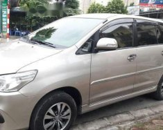 Bán lại xe Toyota Innova E đời 2015, màu vàng cát giá 605 triệu tại Hà Nội