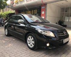 Bán Toyota Corolla Altis 1.8AT sản xuất 2010, màu đen, chính chủ giữ gìn giá 499 triệu tại Hà Nội
