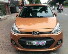 Bán ô tô Hyundai Grand i10 1.2AT sản xuất 2015, màu cam, xe nhập đi giữ gìn giá 383 triệu tại Hà Nội