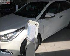 Bán ô tô Hyundai Accent 1.4 ATH đời 2018, màu trắng, giá tốt giá 555 triệu tại Tp.HCM