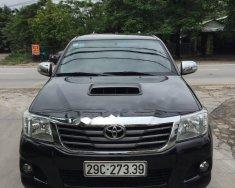 Cần bán gấp Toyota Hilux MT đời 2014, màu đen, xe nhập còn mới giá 480 triệu tại Hà Nội