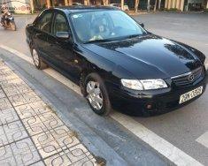 Cần bán lại xe Mazda 626 2001, màu đen, xe gia đình giá 175 triệu tại Hà Nội
