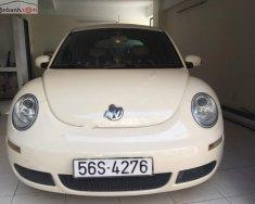Bán Volkswagen New Beetle 1.6 AT sản xuất năm 2010, màu kem (be), xe nhập, giá 600tr giá 600 triệu tại Tp.HCM
