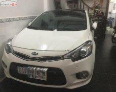 Mình cần bán Kia Cerato đời 2014, đăng kí 1/2015, xe màu trắng giá 650 triệu tại Tp.HCM