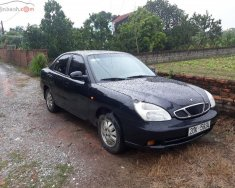 Cần bán gấp Daewoo Nubira 1.6 đời 2002, màu đen, giá tốt giá 75 triệu tại Hải Dương