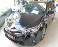 Bán Toyota Corolla Altis 1.8 CVT năm 2016, màu đen, chạy 27.855 km giá 740 triệu tại Tp.HCM