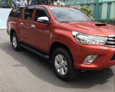 Bán ô tô Toyota Hilux 2.5E năm 2016, màu đỏ, xe nhập số sàn giá 595 triệu tại Tp.HCM