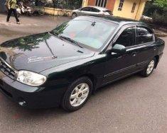 Cần bán gấp Kia Spectra LS 2004, màu đen, xe nhập, số sàn giá 138 triệu tại Hà Nội