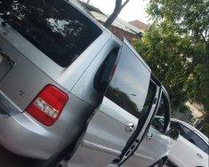 Cần bán xe Kia Carnival sản xuất 2007, màu bạc giá 210 triệu tại Tp.HCM