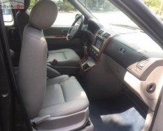 Cần bán lại xe Kia Carnival GS 2.5 AT 2009, màu đen   giá 270 triệu tại Tp.HCM