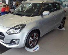 Cần bán xe Suzuki Swift GLX 1.2 AT đời 2018, màu bạc, nhập khẩu nguyên chiếc giá 549 triệu tại Hà Nội